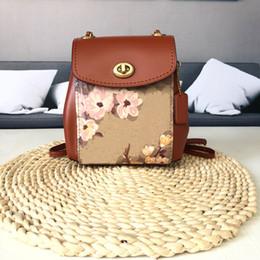 Sacs à main de camélia en Ligne-Designer Bag Luxury Handbags Handbag La nouvelle tendance Camellia Vintage Sac à dos multifonctionnel Patchwork Couleur Sac à chaînes
