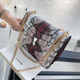 Bloquear bolsas de mensajero online-mujeres de la marca al por mayor bolso de estilo extranjero ba mensajero de cuero nuevo color de la serpiente bolsa de la cadena de serpiente temperamento elegante mujer de bloqueo bolsa de hombro