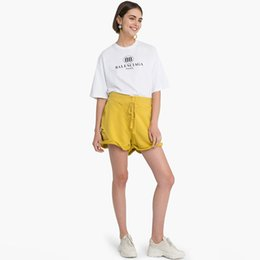 2019 pantalones cortos de talle alto Pantalones cortos de talle alto para mujer, talla grande, pantalones cortos de motociclista Harajuku, agujero de botón sólido ocasional que ahueca hacia fuera a las mujeres rebajas pantalones cortos de talle alto