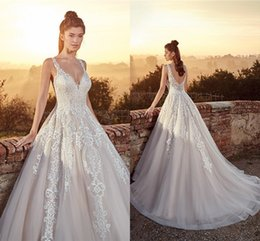 5ebfcf8321b 2019 A Line Wedding Dresses Spaghetti Straps Backless Tulle Floor Length  With Appliques Bridal Gowns Formal Custom Made Cheap