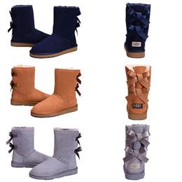 Zapatos de skate de invierno online-Descuento WGG Invierno Mujer Botas de nieve Moda genuina ovejas de cuero de gamuza Australia Classic Warm Winter hombres zapatos de lujo diseñador de arranque 36-41