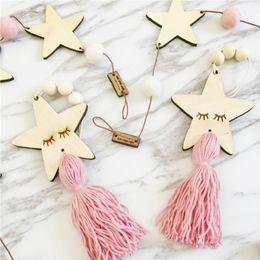 Ornamento borla on-line-Forma de estrela de madeira Beads Tassel pingente de estilo nórdico Pingente de suspensão Decorações Kids Room Decoração de parede ornamento de suspensão para a fotografia