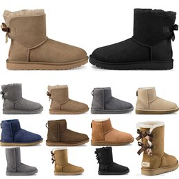 2019 tacchi alti chiusi alla caviglia UGG Boots Australia Classic stivali da neve moda WGG alti stivali in vera pelle Bailey Bowknot donna Mantieni caldo