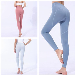 4d2785688a412 Women Skinny Leggings Heart Shaped Sports Gym Yoga Pants High Waist Workout  Tight Ninth Yoga Leggings Home Clothing 20pcs OOA6331