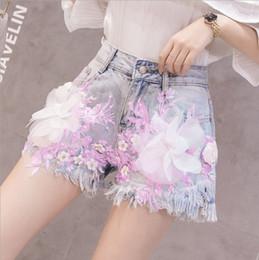 2019 style de célébrités Célébrité Web recommande 2019 nouveau short en jean d'été pour les femmes taille haute perlé fleur pantalon chaud perlé pantalon court en détresse dans le style style de célébrités pas cher