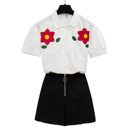 Белые короткие юбки онлайн-sweet flower printed short sleeve white shirt & black skirt skirts two pcs women summer suits top outfit good quality Hot Sale