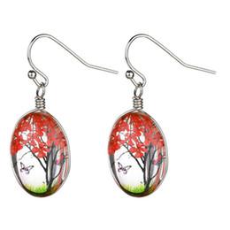 2019 la farfalla ciondola gli orecchini Romantico fiore farfalla fiore ovale forma di albero di vetro ciondola gli orecchini di moda donna affascinante orecchini eleganti chic sconti la farfalla ciondola gli orecchini