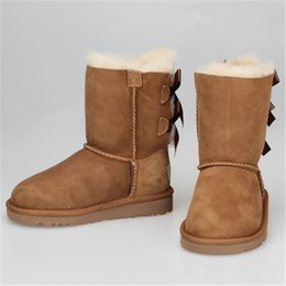 botas de becerro de piel de invierno Rebajas Australia Marca UG niños Botas de piel para la nieve niños niñas Zapatos de diseño Impermeables para el invierno Mantener cálidos Bowknot Estudiantes Botas a media pierna Zapatos al aire libre