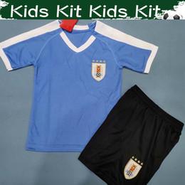 Maglie uruguay online-2019 Kit bambini Maglia da calcio Uruguay Home Maglia da calcio 19/20 # 9 SUAREZ # 21 CAVANI # 3 GODIN Pantaloni da calcio per bambino con pantaloncini