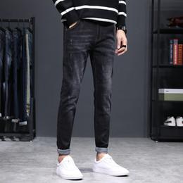 Man Jeans Male Tide Marke Joker elastische Kraft Bound Füße Hosen Trend schwarz Freizeit Long Pants Male Denim Street