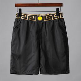 2019 tissus de vêtements de sport Designer de luxe Tissu imperméable Summer Beach Pants Vêtements pour hommes Maillots de bain Shorts de natation Shorts de sport Shorts Pantalons tissus de vêtements de sport pas cher