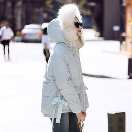 5a2ae12f288 Laurence family RMOJUL winter 2018 new women s clothing Raccoon fur hooded  bow with white duck down down jacket