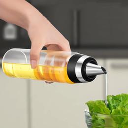 Botellas de aceite vertido online-Botella de aceite de oliva premium Sin goteo Vidrio Pourer de aceite Cocina Contenedor de aceite de oliva Vinagre Botella de pico de medición 350ML 500ML