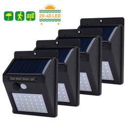 2019 iluminação de energia 20/30/40 LEDs Solar Light PIR Sensor de Movimento Solar Jardim Luz Impermeável de Poupança De Energia Ao Ar Livre Quintal Caminho Caminho Para Casa lâmpada desconto iluminação de energia