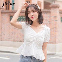 2020 blusas jovenes Camisa de mujer con cuello en v Verano Color sólido Blusa blanca elástica para mujer Manga abullonada Ginger Young S-XL Camisas amarillas Top corto blusas jovenes baratos