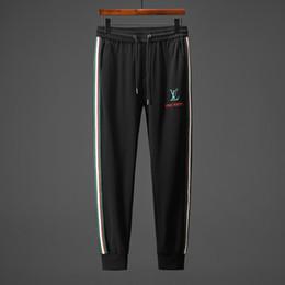Jeans de hip hop tamaño 44 online-High Street Fashion Jeans para hombre Pantalones de chándal casuales Gran bolsillo Pantalones de carga Hombres Marca Clásico Hip Hop Army Tamaño grande ...
