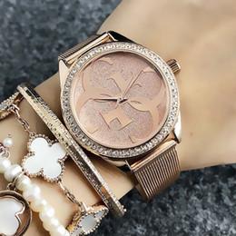 Reloj de metal online-Marca de moda Relojes de pulsera para mujer estilo de cristal dial acero banda de metal reloj de cuarzo GS19