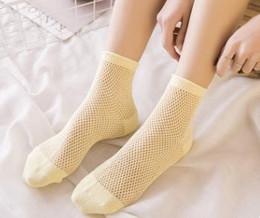 Canada Chaussettes creuses en maille, chaussettes basses de couleur pure, chaussettes en filet de pêche, chaussettes perméables à l'air de printemps et d'été Offre