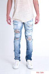 Jeans blancos como la nieve online-Vaqueros para hombres Pantalones de diseñador Blancanieves Azul Cremallera destruida Slim Denim Biker Skinny Jeans Ripped Leggings Ropa