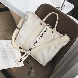 bolsas de cor preta Desconto Bolsas de lona Mulheres Homens Sacos de compras Sacola de compras reutilizável Cor preto branco Sacos