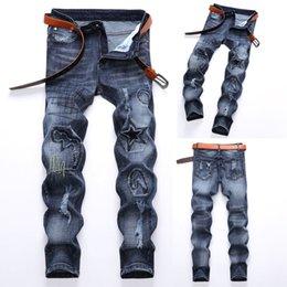 jeans moderni per gli uomini Sconti Foro Vintage Jeans uomo Denim Fold Lavare lavoro sfilacciato cerniera stampato pantaloni di base vendita calda di alta qualità 2018 nuovi modelli moderni