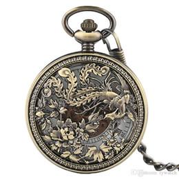 mecánico de cuerda manual de relojes antiguos. Rebajas Bronce antiguo hueco mecánico relojes de bolsillo exquisito Phoenix grabado mano viento Fob reloj hombres mujeres colgante regalo de Navidad Kid