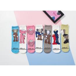 Sevimli Susam Sokak KAWS Kadın Erkek Pamuk Çorap Rahat Orta çorap Karikatür Çift çorap nereden taban taban pedi artırmak tedarikçiler
