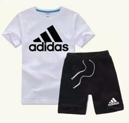 Марка детские наборы 2-9T Детские футболки и шорты брюки детские спортивные костюмы дети спортивный костюм 2 шт./компл. с коротким рукавом наборы лето AB02 от