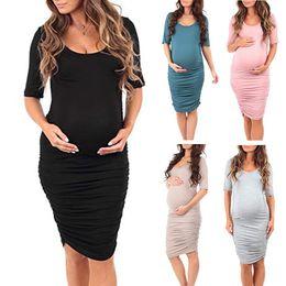 Donna incinta a colori manica corta girocollo pacchetto Glutei vestiti di gravidanza le donne si vestono abiti abbigliamento elegante di maternità da vestito dalla tasca della stampa stella fornitori