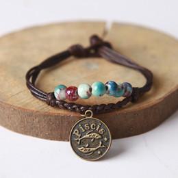 Braccialetti in ceramica di zirconia online-Maxi 12 bracciali in ceramica costellazione Jingdezhen braccialetti fatti a mano per smalto fantasia intrecciati braccialetto di corda per regalo di compleanno, per la fidanzata