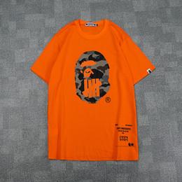 2019 короткая рубашка Лето Мужчины Женщины Черный Белый Оранжевый Мультфильм Печати Футболка мужская Повседневная Свободные Камуфляж Футболки с коротким рукавом скидка короткая рубашка
