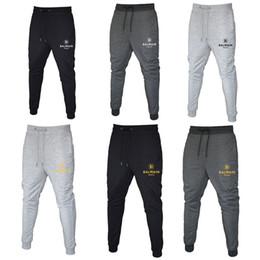 cravate étiquettes en gros Promotion Pantalon Balmain Jogger chino skinny Joggers Camouflage Hommes New Mode Sarouel Couleur longue solides Pantalons Hommes Pantalons