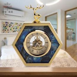tirer l'horloge Promotion Europe Originalité Hexagone Horloge De Cerf Décoration De La Maison De Haute qualité En Métal Horloges De Table Salon Chambre Mute Horloge De Table