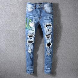 Pantalones vaqueros de los hombres pantalones pantalones Ripped Big hole Moda denim Nuevo 2019 Promoción de alta calidad barato Slim fit Franja blanca Doble serpiente bordado desde fabricantes