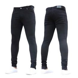 Tallas grandes 3XL Pantalones elásticos ocasionales 2019 Verano Moda Sólido Hombre Negro Jeans ajustados Pantalones de mezclilla ajustados desde fabricantes
