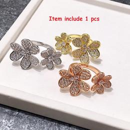 Argentina Nueva marca con cristal de diamante trébol seis pétalos se abren las flores suena el doble par de regalo de la joyería al por mayor de los anillos de los amantes del regalo Suministro