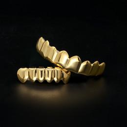 Argentina 4 dientes de color Grillz 8 conjunto de Grillz superior e inferior de 6 con moldes de silicona joyería Hip Hop para mujeres hombres moda vampiro Suministro