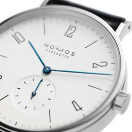 2019 минимализм часы мужчины Женские часы Марка NOMOS мужчины и женщины Минималистский дизайн Кожаный ремешок Мода Простые кварцевые водостойкие часы скидка минимализм часы мужчины
