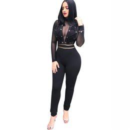 2019 vedere i bodysuits Sexy Mesh See Through Black Tute Occhielli in metallo Bandage Torna Zipper Bodycon Body Tute trasparenti per donna sconti vedere i bodysuits