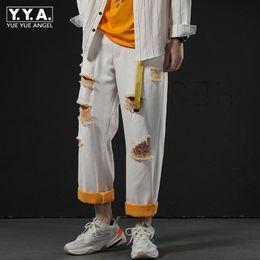 2019 белые широкие ножные джинсы New Fashion Mens Straight Wide Leg Pants Hole Ripped White Jeans Man BF Casual Hip Hop Loose Fit Denim Ankle Length Harem Pants дешево белые широкие ножные джинсы
