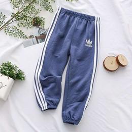 2019 12 meses ropa de marcas para niños Pantalones de diseñador para niños 2019 Nueva marca de moda Pantalones de chándal de color sólido Pantalones con estampado casual Rayas lindas Ropa de deporte Ropa de niños niñas