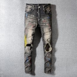 2019 strappato i jeans scarni grossi buchi Mens Jeans Biker High Street slim fit jeans strappati Maschio Distressed Hole Magro Lavato Big Hole Zipper Jeans Asiatica Misura 28-40 sconti strappato i jeans scarni grossi buchi