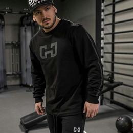 2019 ropa interior negro brillante Hombres camiseta manga larga Running camiseta gimnasia de la aptitud Entrenamiento del músculo deportes ocasionales Tee Tops