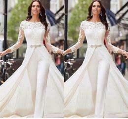 Плюс размер комбинезоны рукава онлайн-Vestidos De Novia с длинным рукавом белый Комбинезоны Платья венчания шнурка сатин с Overskirts Бусины кристаллы Плюс Размер Свадебные платья Брюки платье