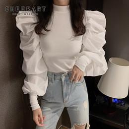 Senhoras moda tops on-line-CHEERART Puff Sleeve Top Turtleneck malha Womens Tops e blusas Black White Ladies coreana Blusa roupa elegante