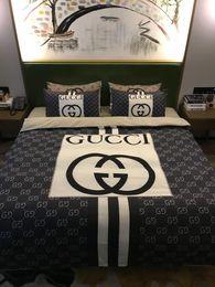 Comforter per letti queen size online-Set di biancheria da letto di lusso di design Set di lenzuola queen-size Lenzuola di cotone 4 pezzi Set di trapunte da letto di marca consolatore