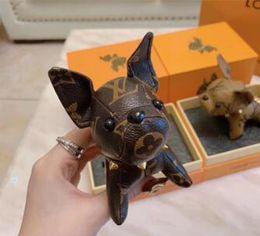 Pulsera de cachorro online-2019 diseño de marca original Super Cute Puppy Llavero Bolsa Colgante Llaveros de coche Decoración Equipajes Bolsa Piezas accesorios Regalos envío gratis