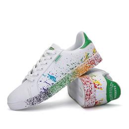 Zapatos de bajo comercio online-Modelos de explosión AliExpress de comercio exterior Color de inyección de tinta Bajo para ayudar a las parejas Zapatos deportivos de tendencia Zapatos pequeños y blancos Tamaño grande 4546