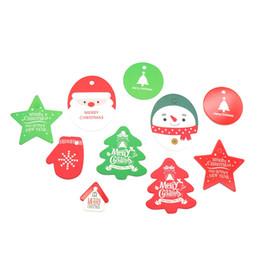 Estrelas papel de natal on-line-50 pcs Tag Estrela de Natal Papai Noel Tags Cartão de Papel Kraft Tag Saco de Doces Decoração Pacote de Presente de Natal Tags Decoração Suprimentos