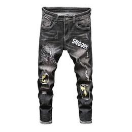 Calças de brim dos homens elegantes on-line-Ripped Jeans para homens moda Hip-hop Slim Fit Jeans Streetwear Crânio Bordado Lavados Buraco Destruído Preto Jogger